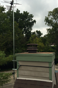 TV antenna mounted on wood chimney